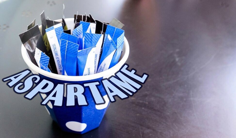 cup-of-aspartame-packets-with-word.jpg